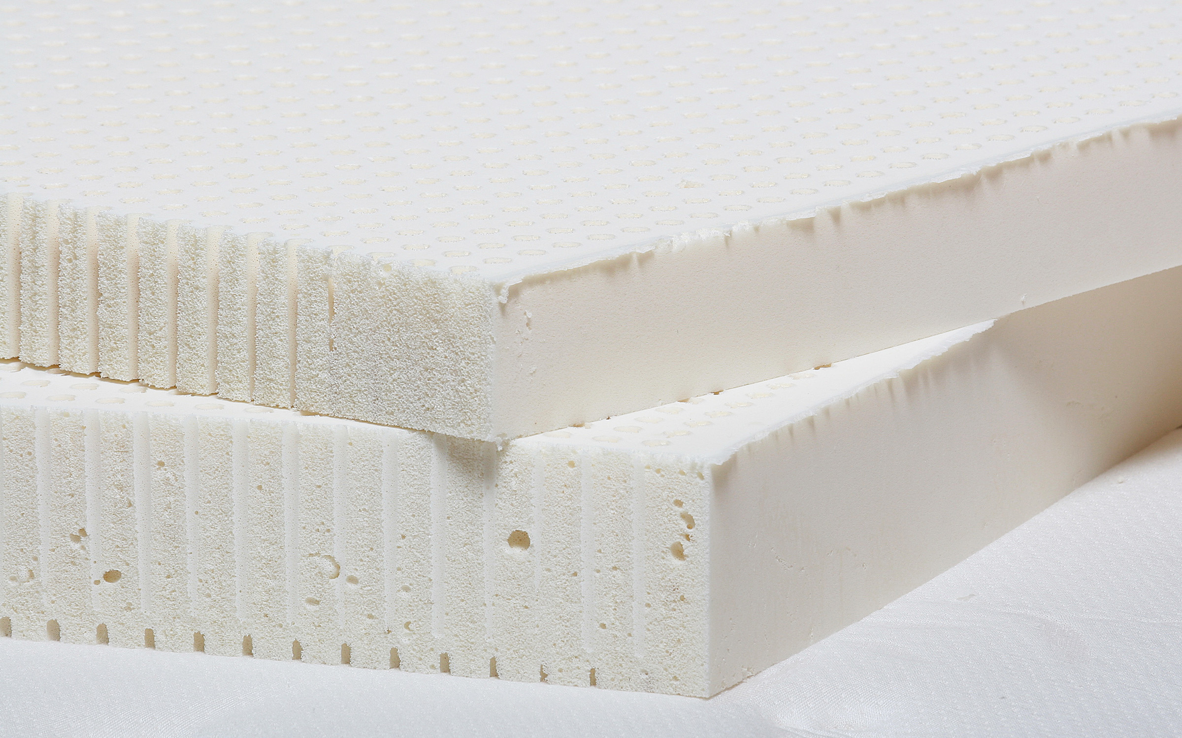 Close up of natural Talalay latex toppers which can be sized to fit any mattress.