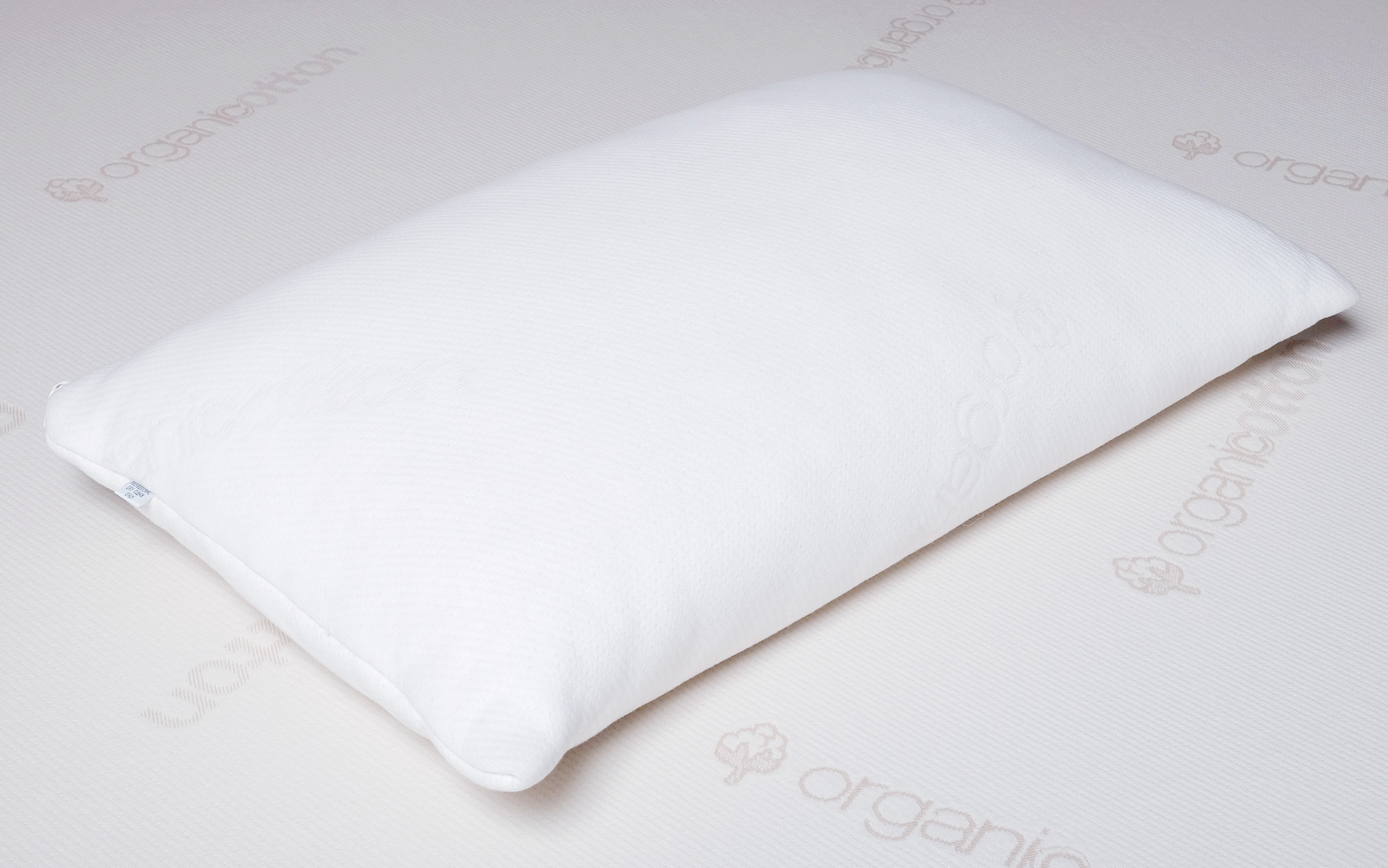 Natural shredded latex pillow allows for easy adjustment for firmness and loft.