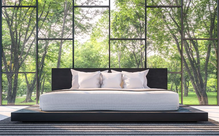 A natural latex mattress in a beautiful bedroom with a wonderful view.
