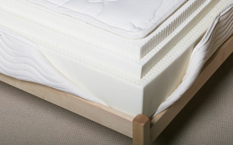 Detailed view of 10 inch latex mattress showing 3 layers of natural Talalay latex.
